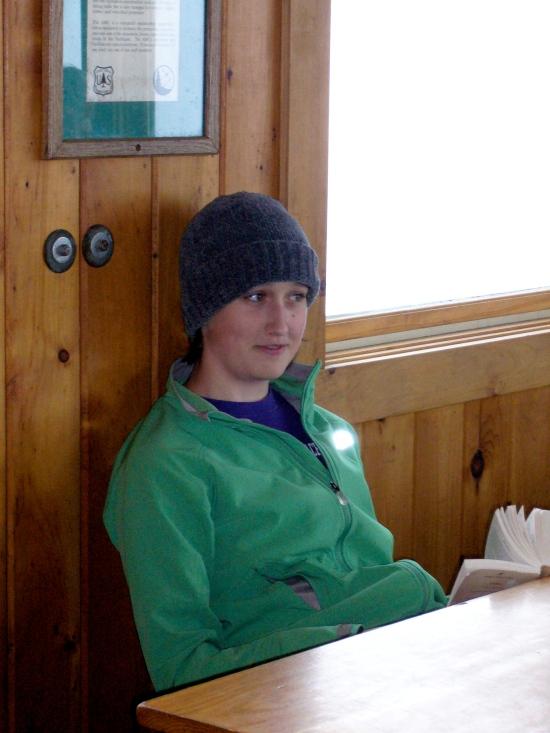 Madeleine reading in the Greenleaf Hut.