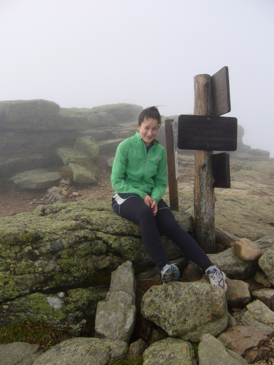 Madeleine is at the summit of Mt. Lafayette.
